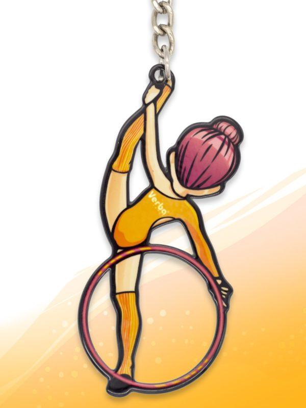 Брелок VERBA SPORT гимнастка с обручем Н (оранжевый) 8*3,7 см.